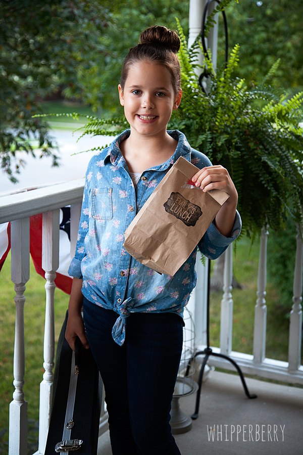 Emily with her lunch sack