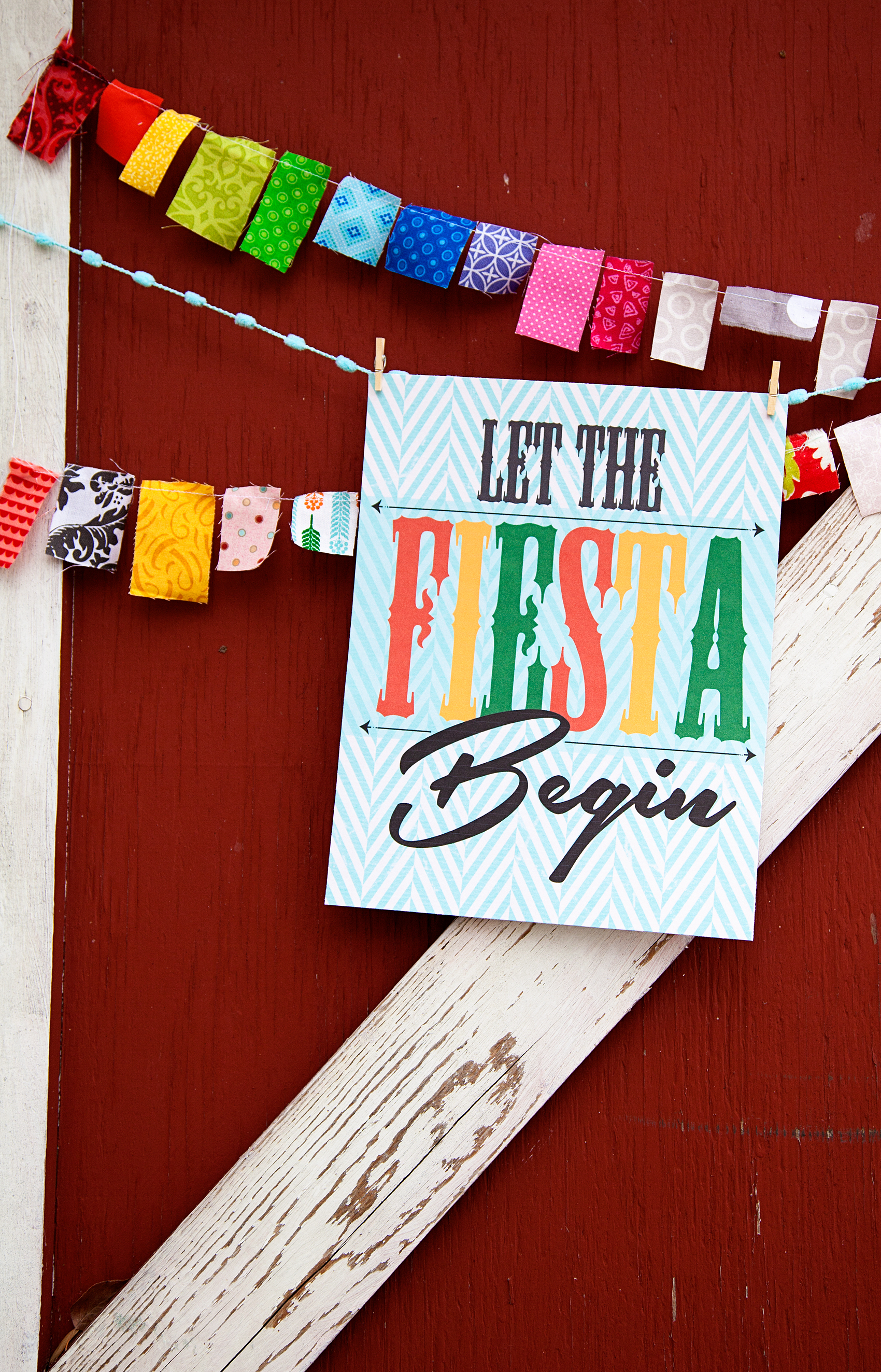 "Add a little flair to your Cinco de Mayo Fiesta with this colorful ""Let the Fiesta Begin"" free printable sign from WhipperBerry"