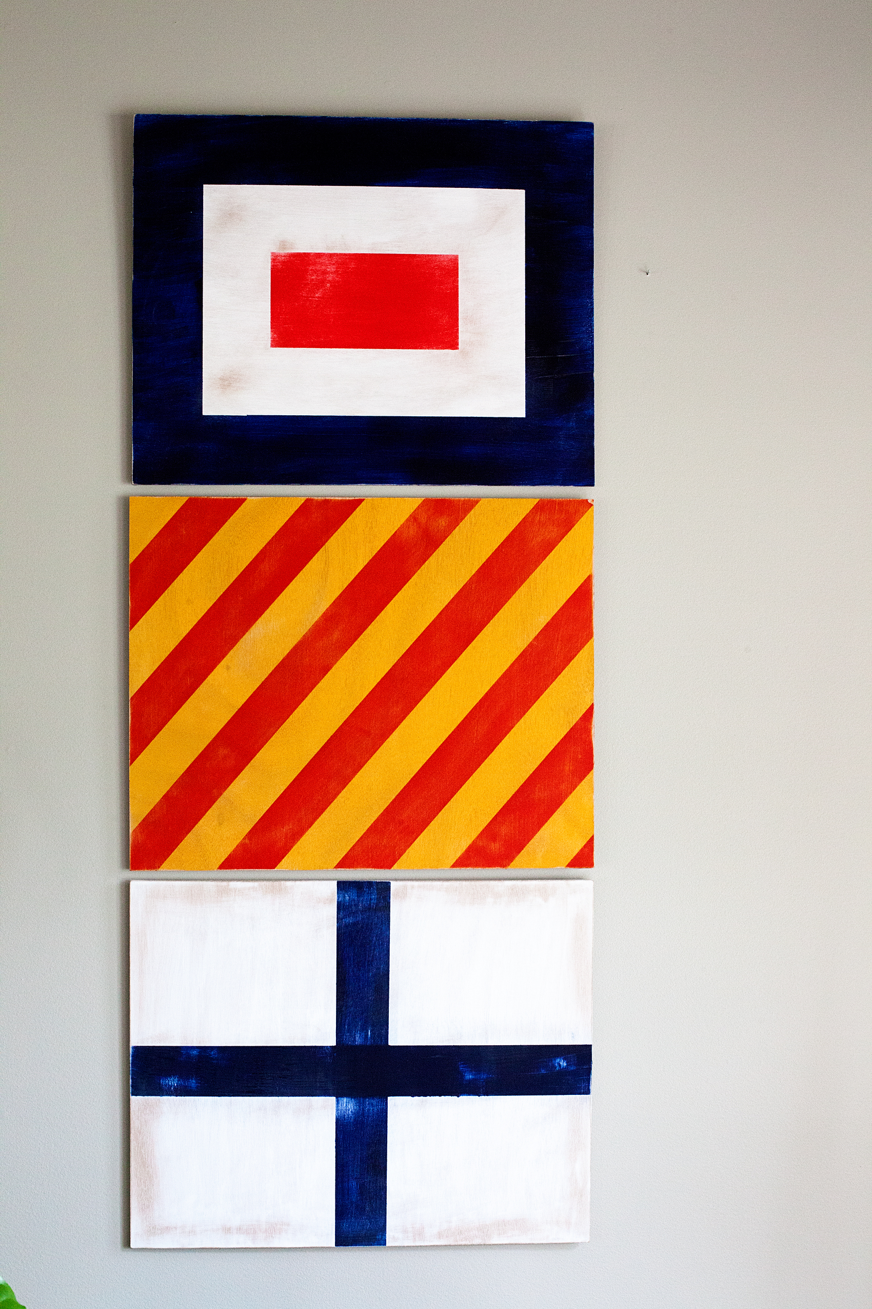 Looking for a fun way to dress-up your boys room? Vintage Nautical is one of my favorite ways to decorate for my little guy. Come learn how I created these painted nautical signal flags for Gage's room...