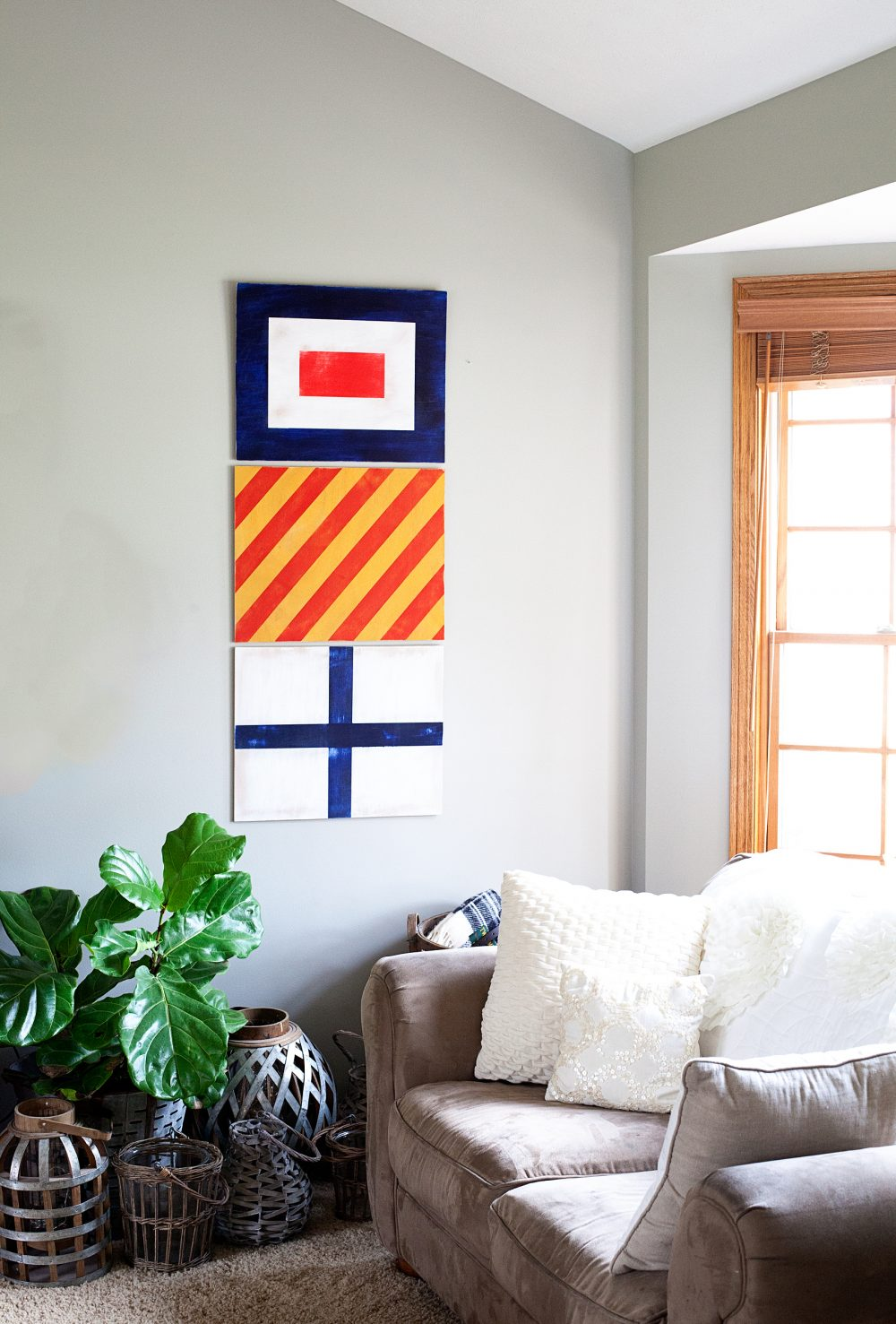 Looking for a fun way to dress-up your boys room? Vintage Nautical is one of my favorite ways to decorate for my little guy. Come learn how I created these painted nautical signal flags for Gage's room... WhipperBerry