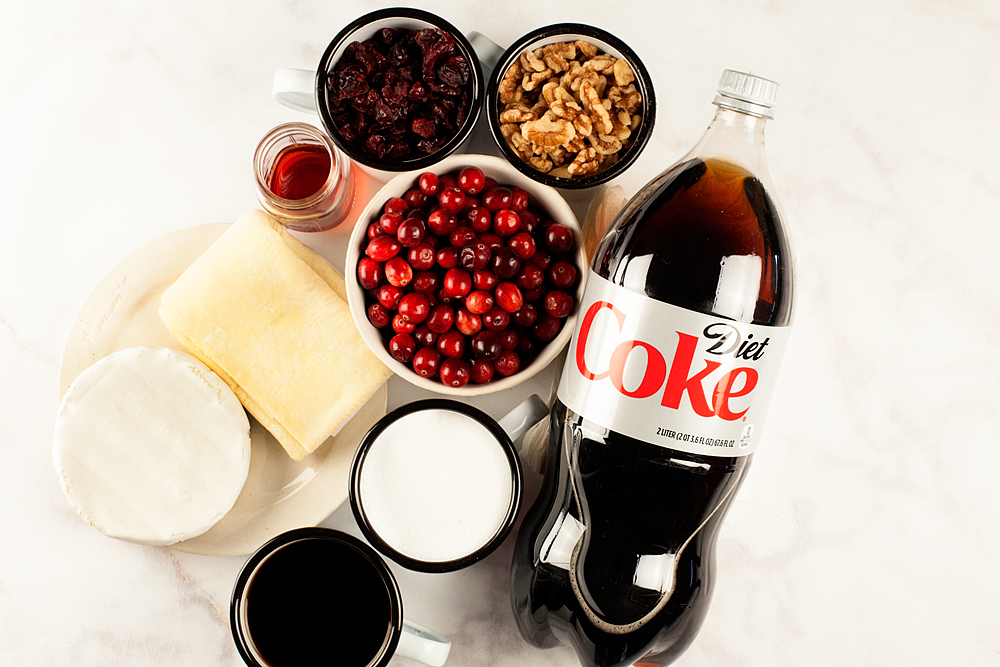 Try this scrumptious Diet Coke Cranberry Walnut Chutney with Brie in Puff Pastry. It's a fabulous Holiday appetizer that everyone will love! You can stock-up on all the ingredients including @dietcoke at @samsclub - Recipe and video created by WhipperBerry