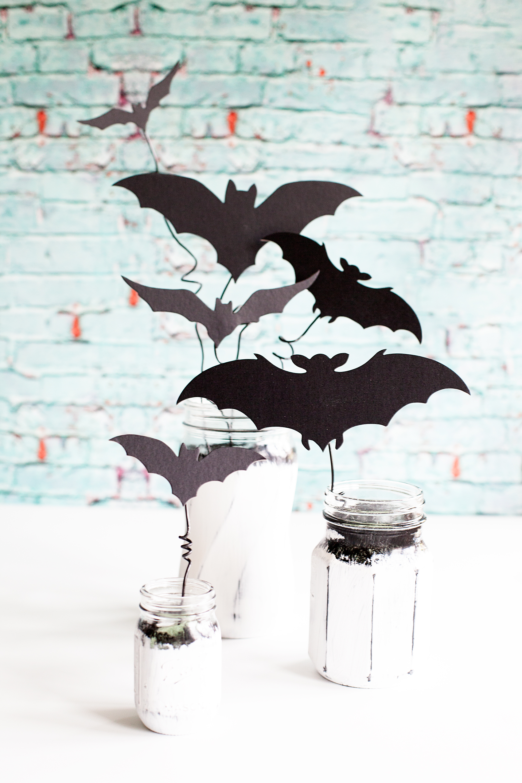Chalky Finish Halloween Bat Jars • Have fun creating spooky Halloween decor with these Americana Decor Chalky Finish Ball Jars filled with creepy bats. Decorate your mantle or use them as a table centerpiece. Either way, they will add some stylish fun to your Halloween decoration game.