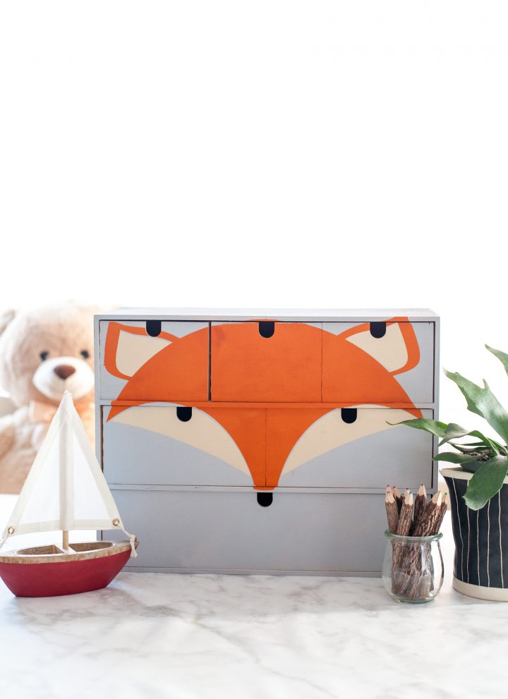 Transform a simple mini storage chest from IKEA into this cute little fox storage chest for your little ones little toys and trinkets. I used some of the @decoart chalky finish paint along with my @cricut Maker to create this fun design for my little boys room • WhipperBerry