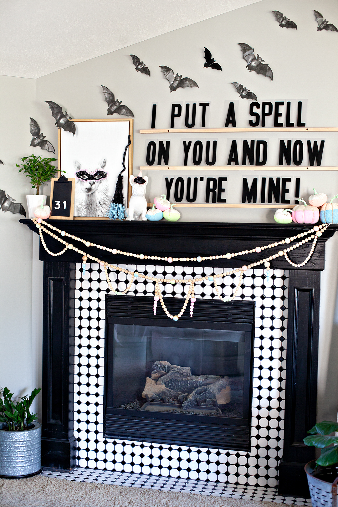 When it comes to my typical style choices I typically stick with classic and timeless. However, I also have a real love of fun and whimsey that sneaks out every once in a while.  This year I've created a whimsical mantel using all kinds of fun finds from DecoArt, Target & Refined Design for my whimsical NEON Halloween mantel!